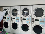 MESIN LAUNDRY STACK KOIN